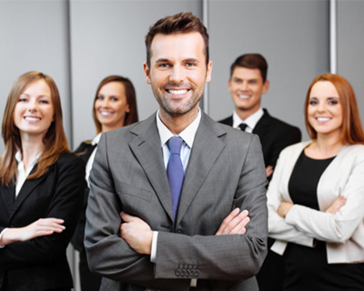 businessmen and businesswomen smiling