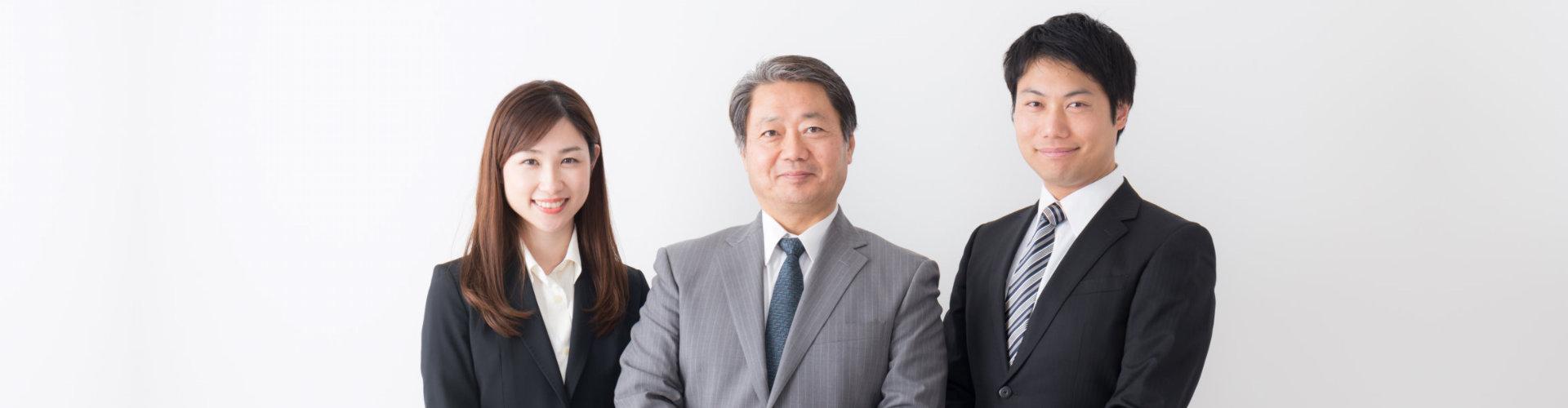 three professionals smiling
