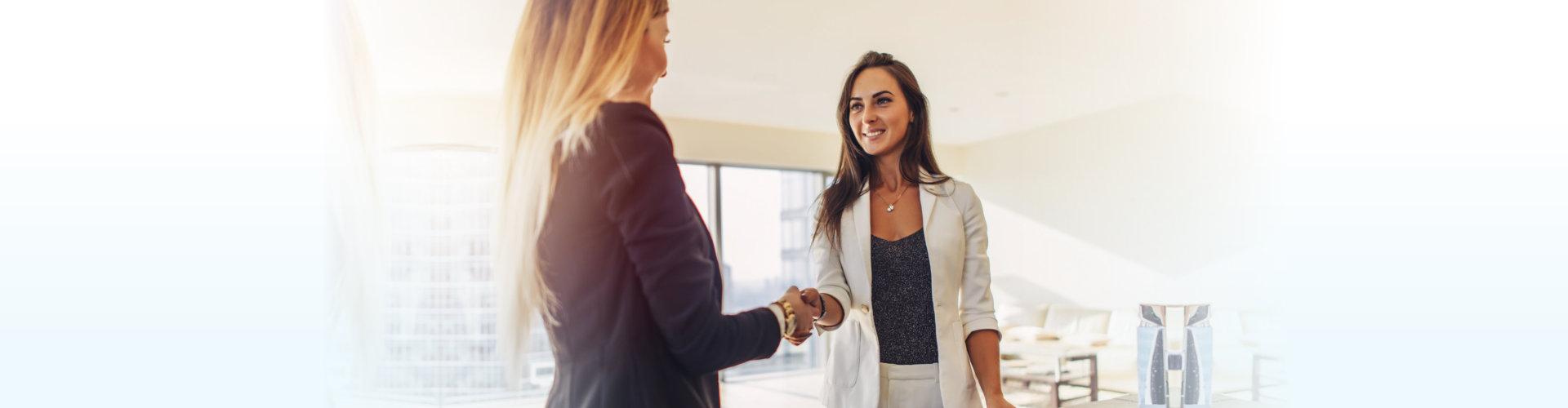 two women having a handshake